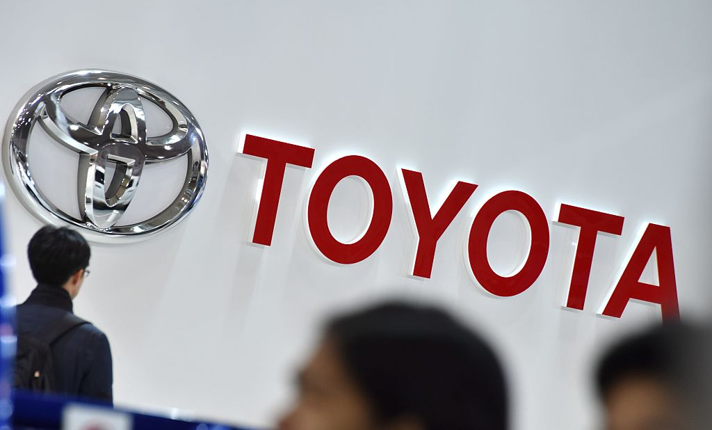 a toyota logo at a showroom in tokyo