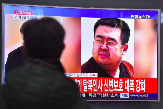 A man watches a television showing news reports of Kim Jong-Nam, the half-brother of North Korean leader Kim Jong-Un, in Seoul