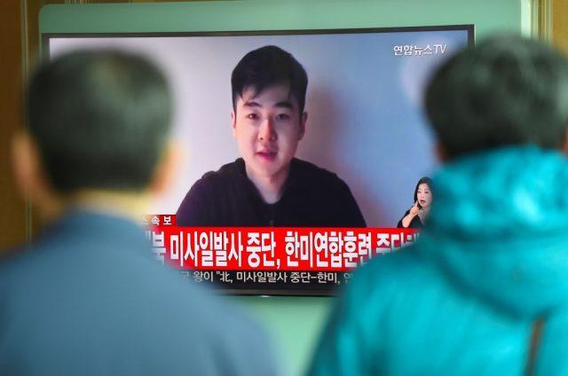 South Koreans watch a television news showing a video footage of a man who claims he is Kim Han-Sol, a nephew of North Korea's leader Kim Jong-Un, at a railway station in Seoul