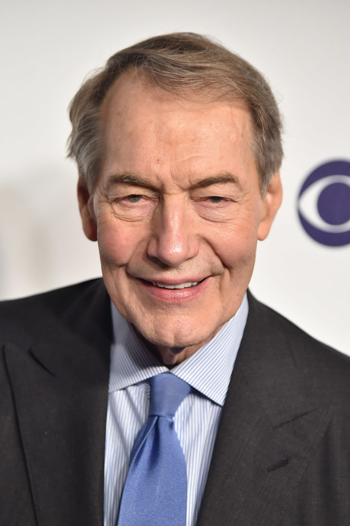 charlie rose in a dark suit and blue tie