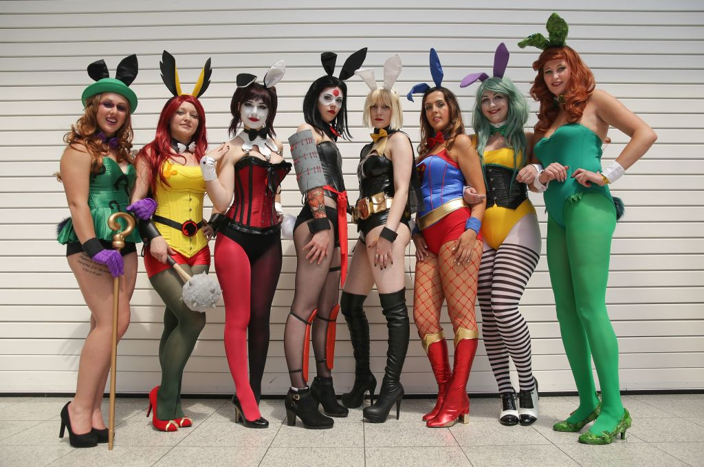 a group of women dressed as superheroes