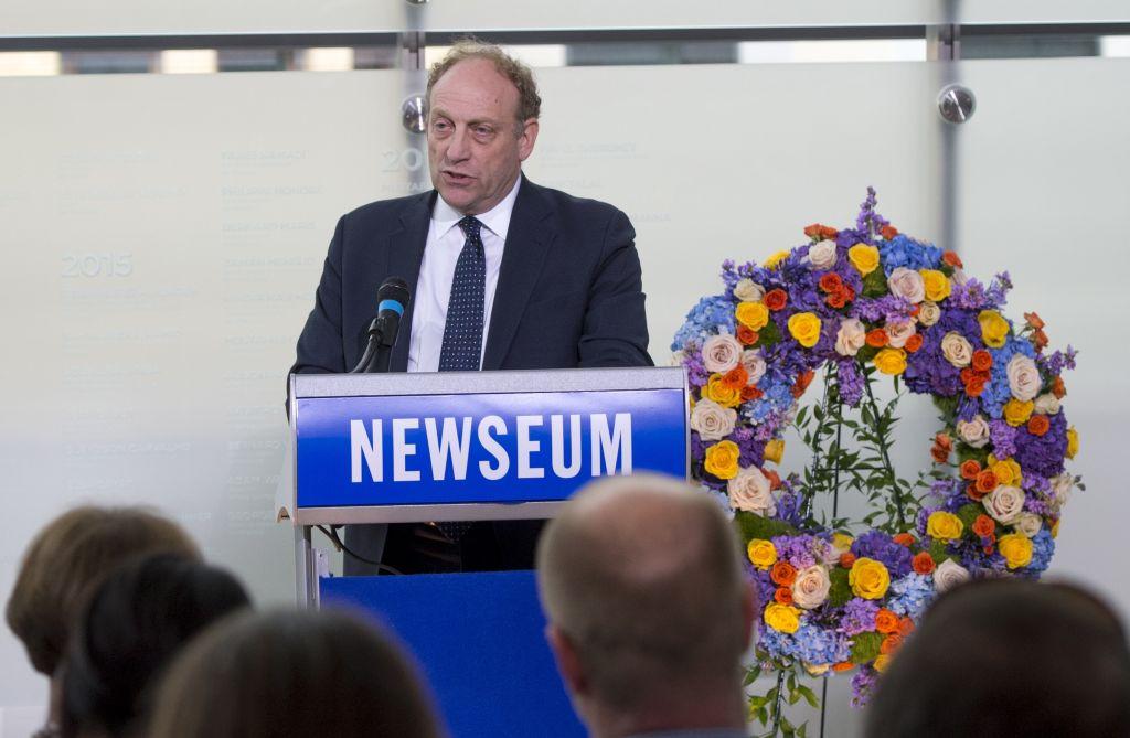 michael oreskes at a newseum podium