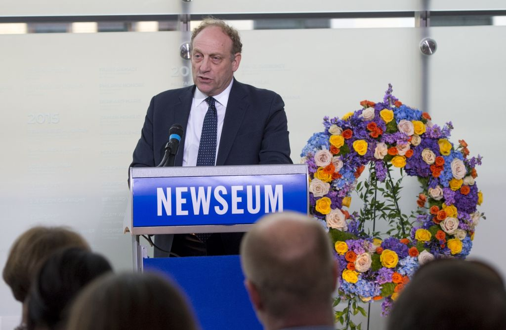 michael oreskes at a newseum podium