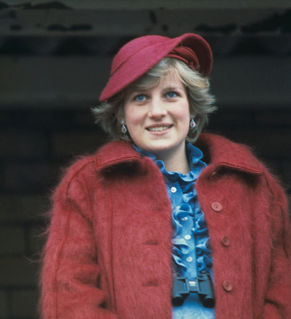 princess diana in a red coat and hat