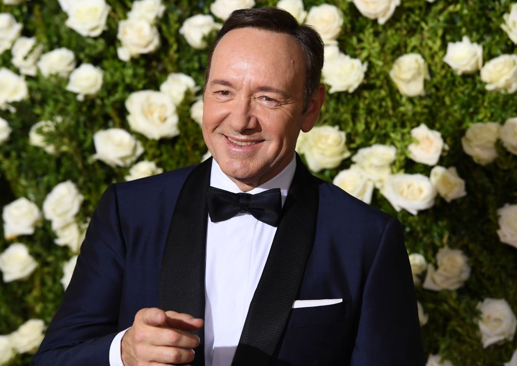 kevin spacey in a tuxedo with flowers