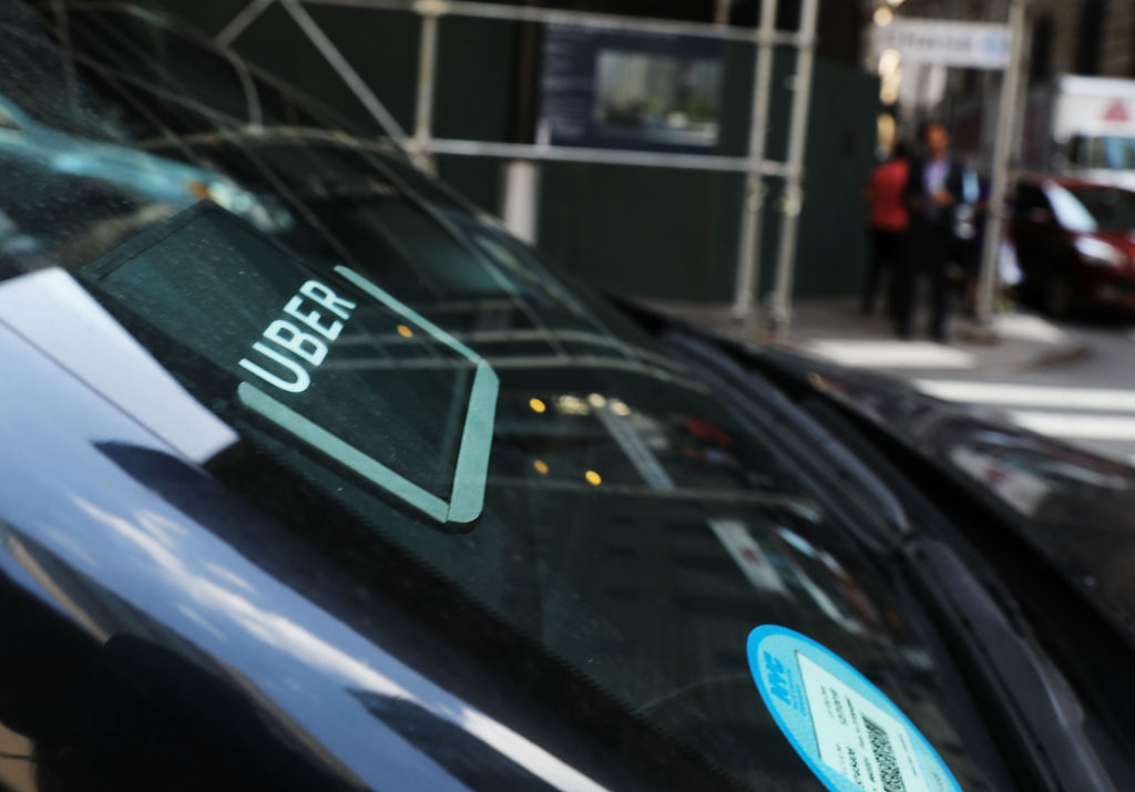 An Uber car waits for a client in Manhattan