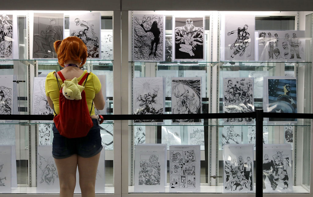 a girl in front of a black and white wall of comics
