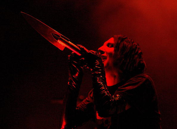 marilyn manson sings onstage with a knife microphone