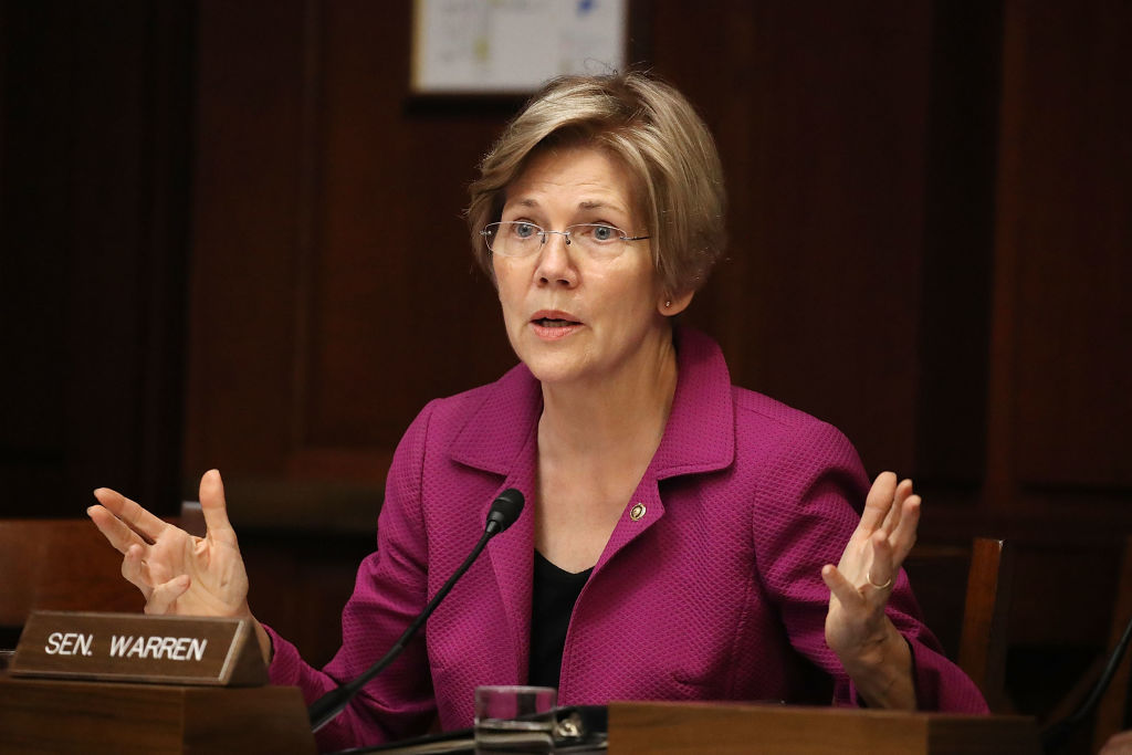 elizabeth warren in a maroon blazer in the senate