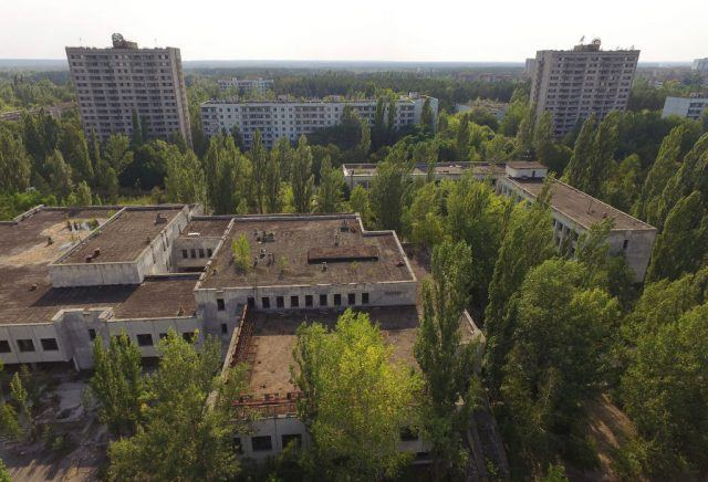 In this aerial view abandoned buildings stand near the main square in the ghost town of Pripyat not far from the Chernobyl nuclear power plant.