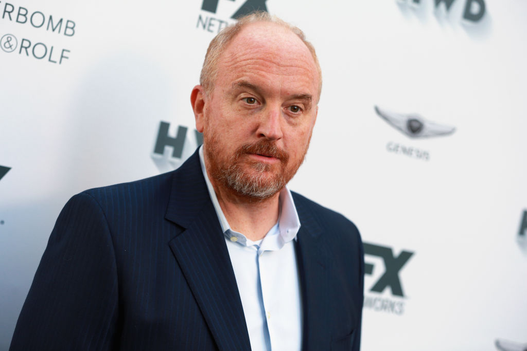 louis CK at a FX red carpet in a blazer and blue shirt
