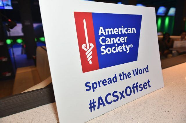 American cancer society sign on a table