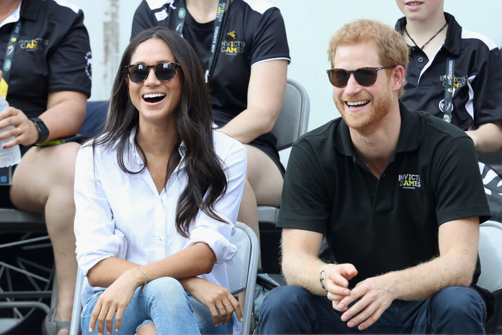 meghan markle in white and prince harry in black attend the Invictus Games