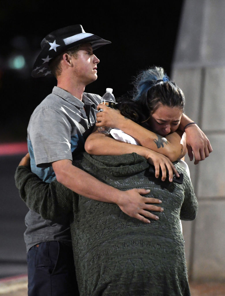 people hug with a police officer after las vegas shooting