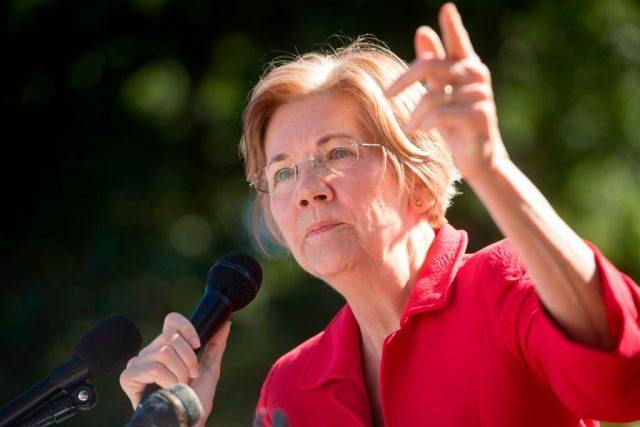 US Senator Elizabeth Warren, Democrat from Massachusetts, speaks to demonstrators as they hold a protest to demand more recovery assistance for areas hit by recent hurricanes