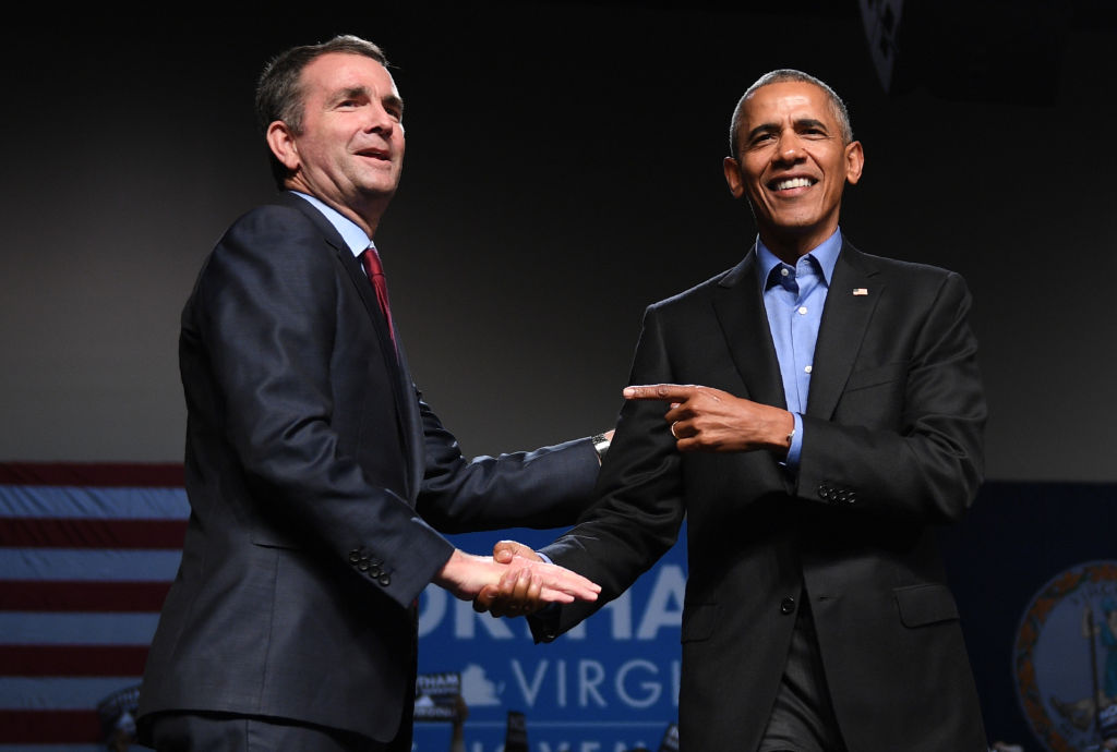 Ralph Northam in a dark suitshakes hands with Barack Obama in a dark suit