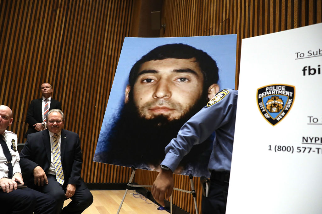 the mug shot of the NYC terror attack suspect at a press conference