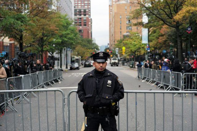 A police officer in front of a barricade in NYC.