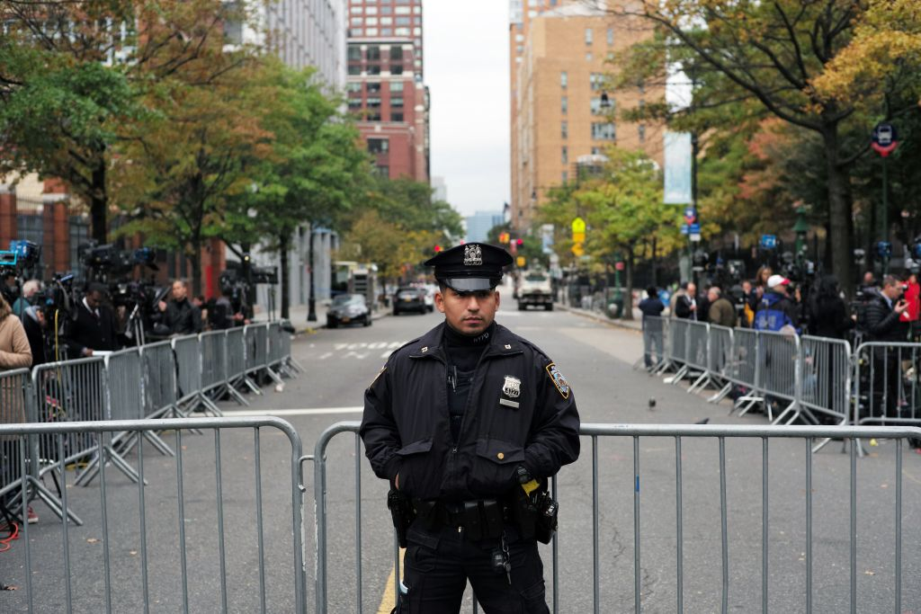 a police officer in front of a barricade in NYC