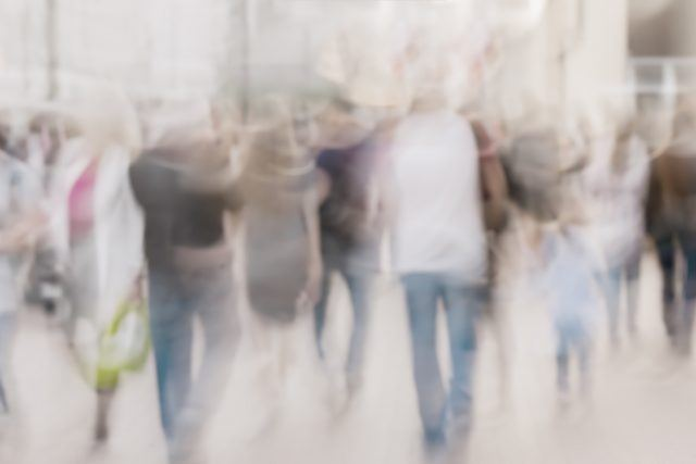 A group of blurred people scurrying about.