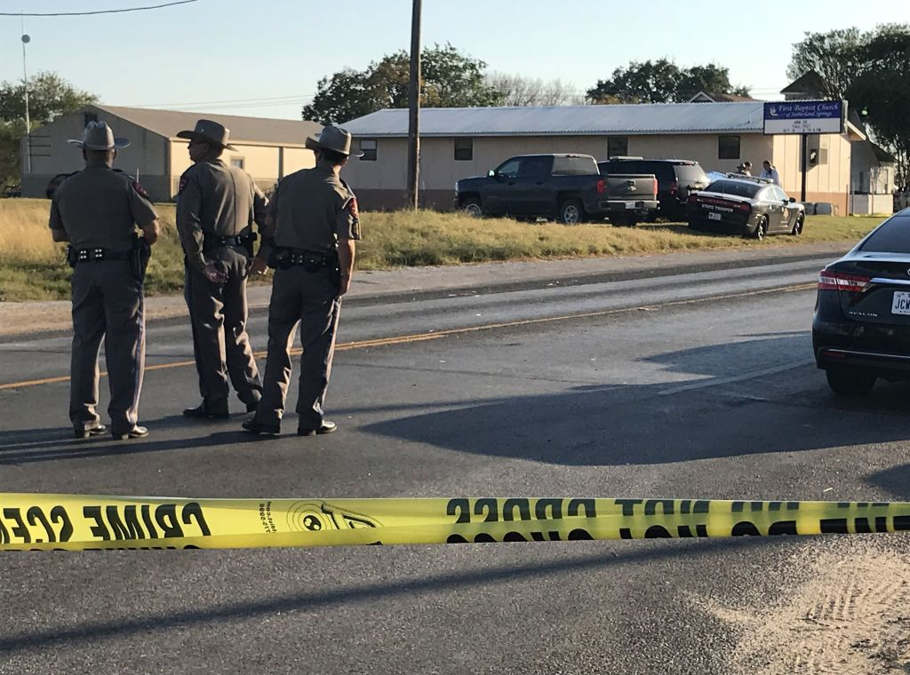 police block a road with police tape in sutherland springs, texas