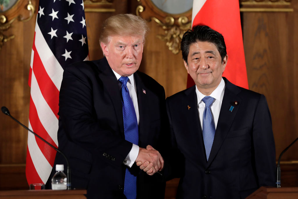 donald trump and shinzo abe in tokyo, both in dark suits and blue ties