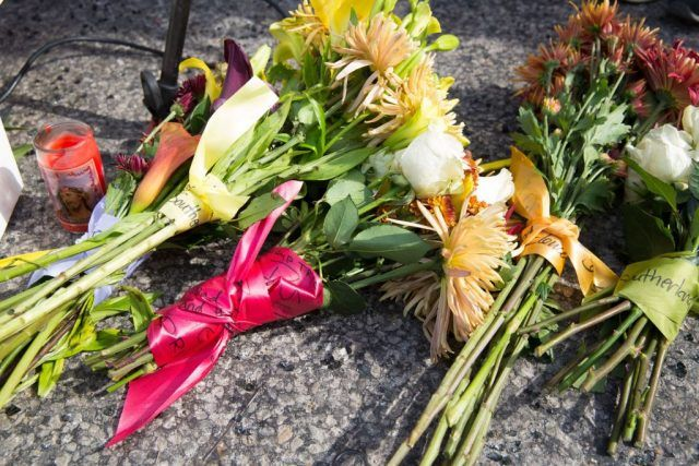 Flowers are laid down in memory of victims of mass shooting.