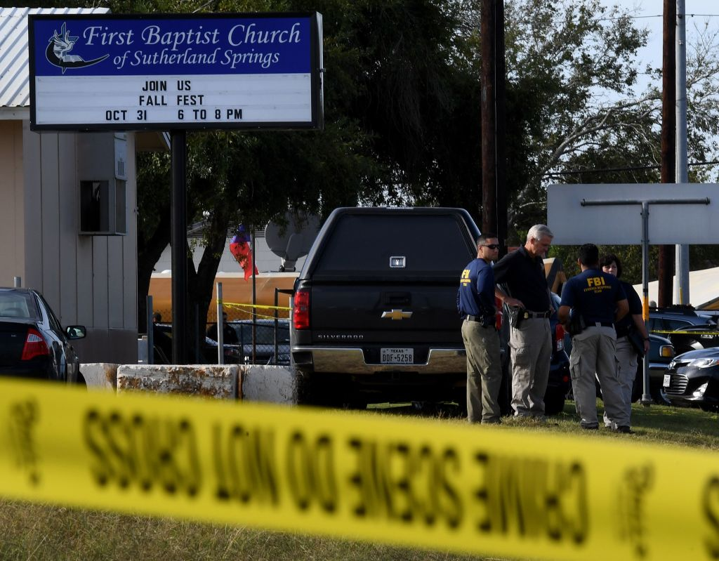 police and caution tape outside the first baptist church in sutherland springs, texas