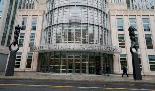 People walk past the Federal Courthouse in Brooklyn