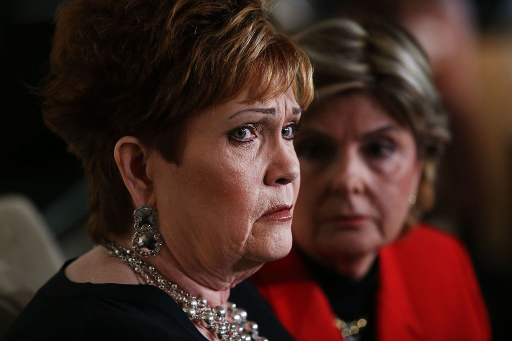 one of moore's accusers in court with her lawyer