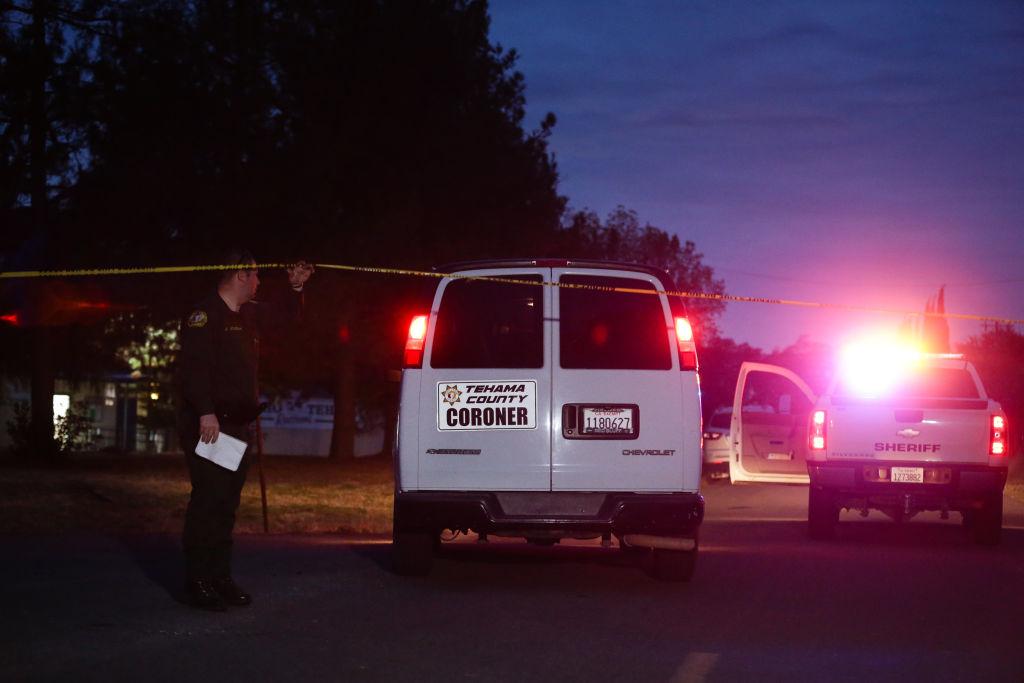 a coroner's van at night outside rancho tehama elementary school
