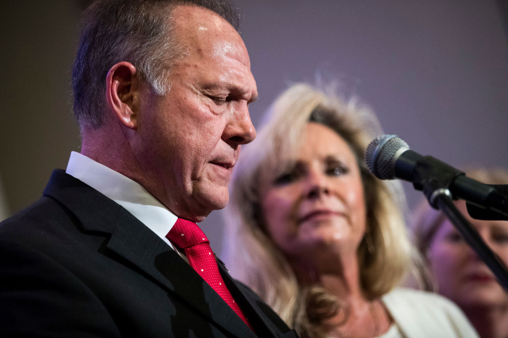 roy moore in a suit and red tie with kayla moore in white