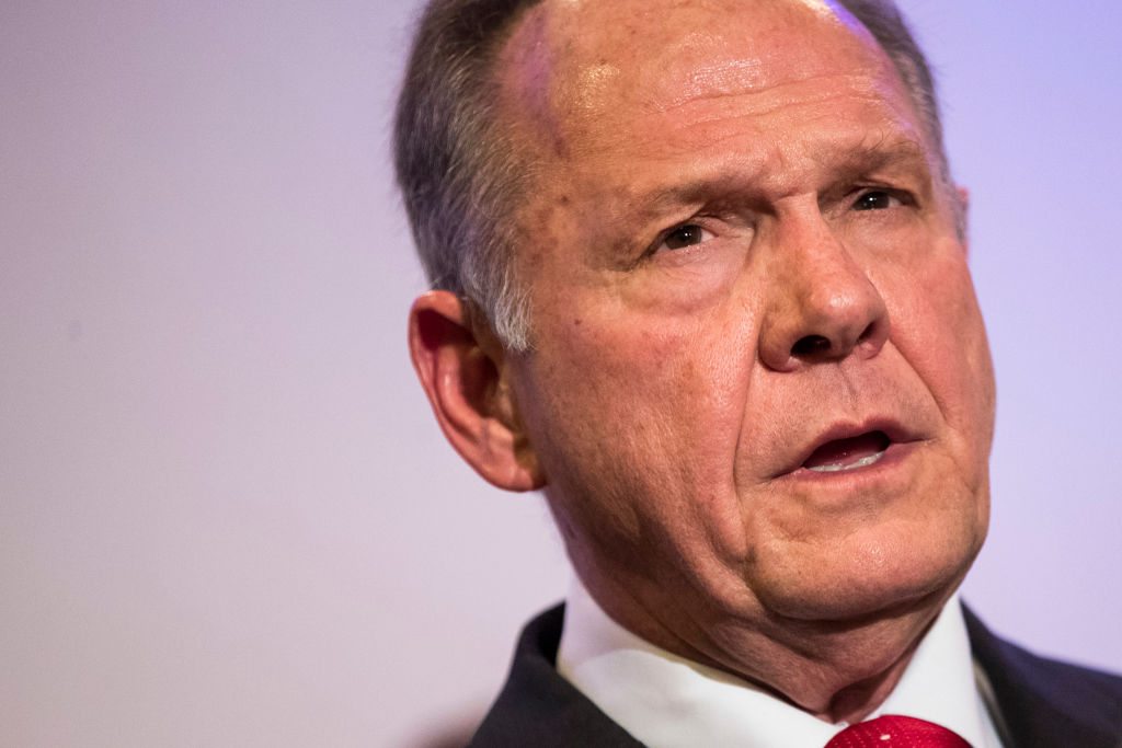 roy moore closeup in a white shirt, dark suit, red tie