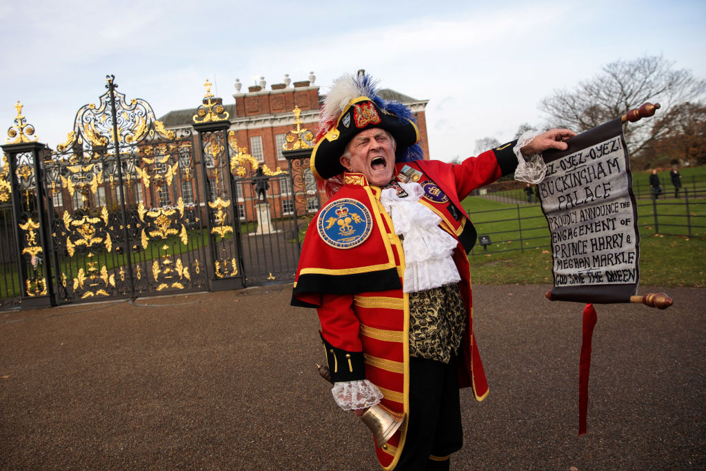 a costumed town crier outside kensington palace