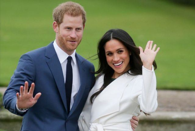 Britain's Prince Harry and his fiancée US actress Meghan Markle pose for a photograph in the Sunken Garden at Kensington Palace in west London on November 27, 2017,
