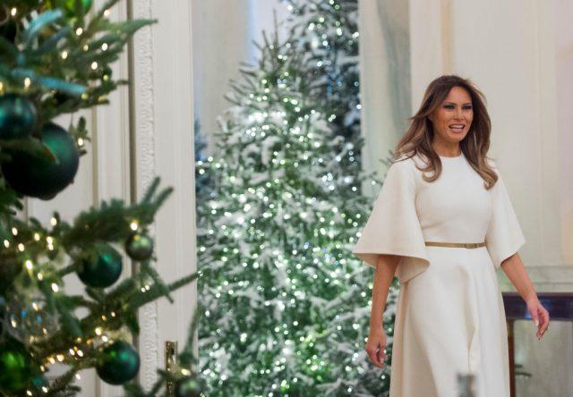 US First Lady Melania Trump walks into the East Room as she tours Christmas decorations at the White House.