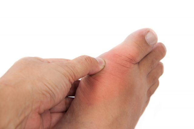 A person holds their foot.