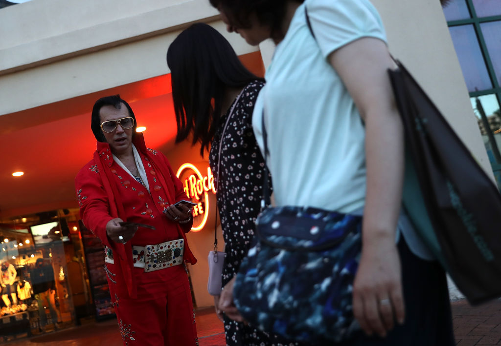 An Elvis impersonator hands out fliers in front of Hard Rock Cafe on August 15, 2017 in Tamuning, Guam. The American territory of Guam remains on high alert as a showdown between the U.S. and North Korea continues. North Korea has said that it is planning to launch four missiles near Guam by the middle of August. Guam home to about 7,000 American troops and 160,000 residents. (Photo by Justin Sullivan/Getty Images)