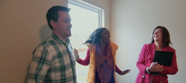 A couple looking at a house on 'House Hunter's.