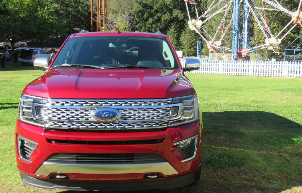 Front view of 2018 Ford Expedition Platinum with ferris wheel in background