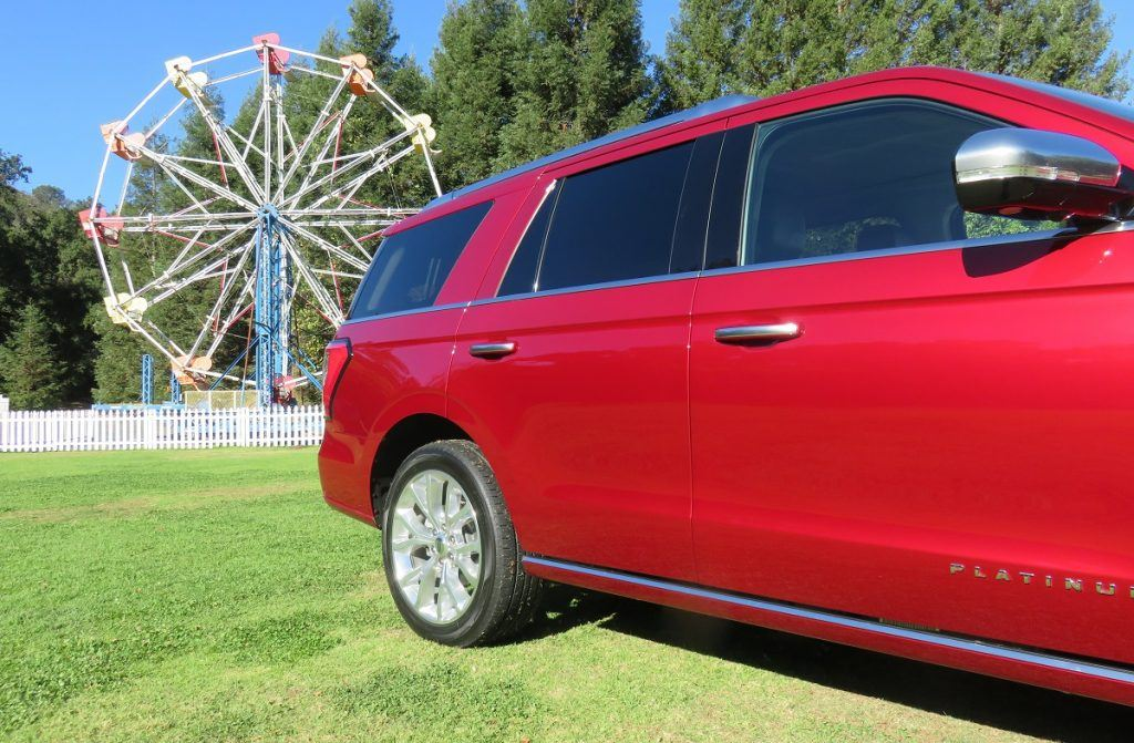 Look at passenger side of red 2018 Ford Expedition toward the rear