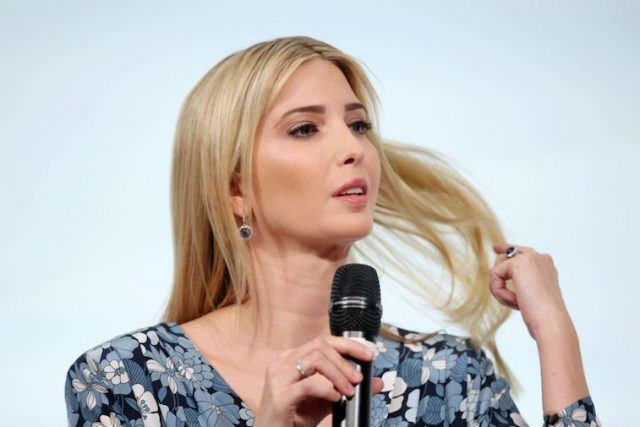 Ivanka Trump speaks on stage while holding a microphone with her right hand.