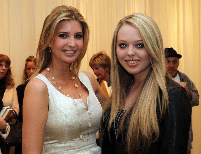 Ivanka and Tiffany Trump smiling and posing together.