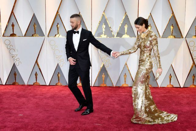 Jessica Biel and Justin Timberlake walking on a red carpet.