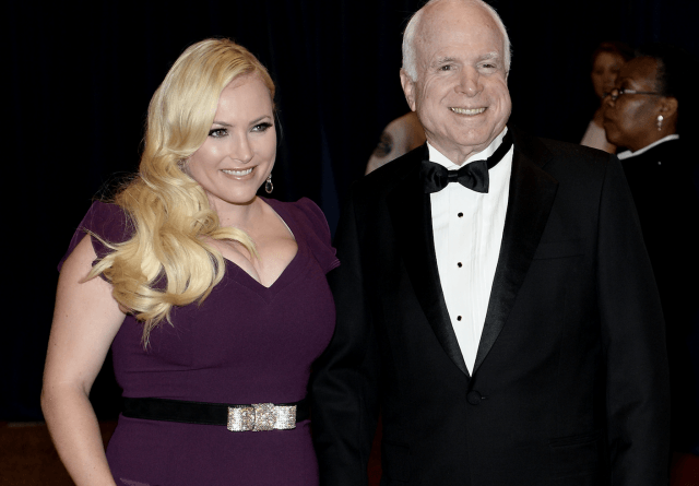 John McCain and his daughter pose at a formal event.