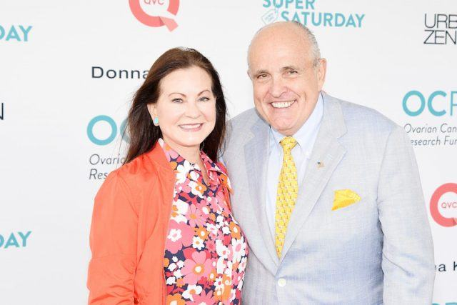 Judith Nathan smiles while standing next to Mayor Giuliani.