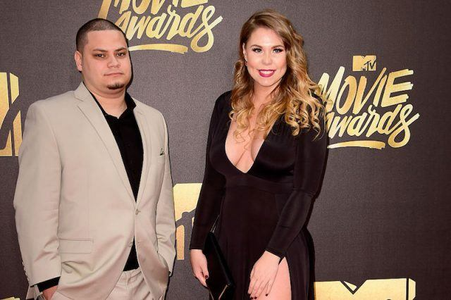 Amber poses with her husband on a red carpet.