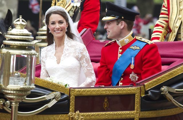 Kate Middleton riding in an elaborate carriage with Prince William.