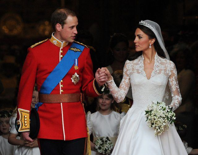 Prince William and Kate Middleton holding hands at their wedding.