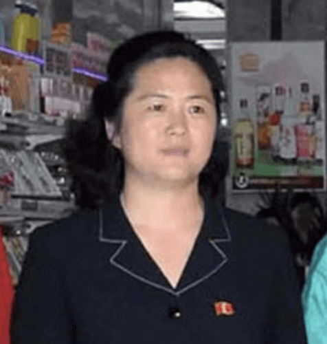 Kim Sul Song stands in a store wearing a black dress.